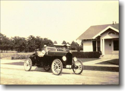 Historic Photo of L.A. old time car with Scott's Grandfather and Mom as a child.